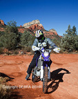 Tourist on dual-sport motorized dirt bike explores Soldier Pass in Sedona