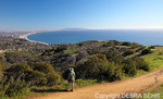 Hiker in the Santa Monica Mountains looks at Santa Monica Bay