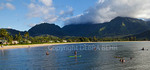 Stand up paddleboarders and swimmers in Hanalei Bay on Kauai