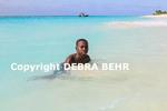 Boy in sea at Shoal Bay in Anguilla