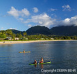 Children enjoy Hanalei Bay on Kauai