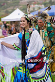Native American teenager followed by her father participate in the Chumash Day Powwow and intertribal gathering in Malibu, California