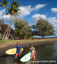 Couple with surfboard and stand up paddleboard in Maui