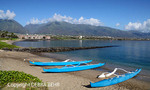 Outrigger canoes beached by Kahului Harbor on Maui