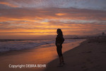 Woman at Santa Monica Beach at sunset