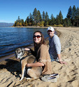 Couple with dog relax in Lake Tahoe