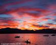 Kayaker paddles at sunset in Lake Tahoe