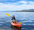 Kayaker paddles in Lake Tahoe
