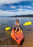 Kayaker at shoreline in Lake Tahoe