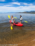 Women prepare to kayak in Lake Tahoe