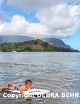 Two-year-old on boogie board in Hanalei Bay