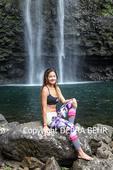 Woman at Hanakapiai Falls on Kauai, reached on a four-mile, one-way hike