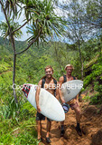 Hikers carry surfboards on the Kalalau Trail; men surfed at Hanakapiai Beach