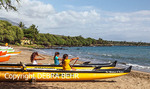 Girls in outrigger canoe club practice at Canoe Beach
