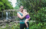 Mother and child by Maui waterfall