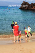 Snorkelers by Black Rock at Kaanapali Beach on Maui