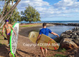 Surfer and SUP at Launiupoko State Wayside Park in Maui (couple in foreground MR; others not MR)