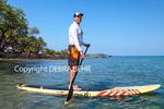 Stand up paddle boarder in Anaehoomalu Bay on the Big Island