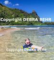 Girl enjoying beach day in Haena, Kauai, with Mt. Makana, called Bali Hai, in background