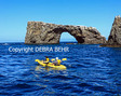 Kayakers by Arch Rock off Anacapa Island in Channel Islands National Park