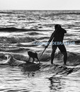 Keoni Durant and his dog, Milo, surfing in Hanalei Bay