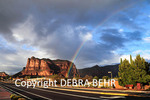 Street scene in Village of Oak Creek, with rainbow at the Courthouse Butte