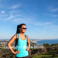 Hiker in the Santa Monica Mountains with Santa Monica Bay in background