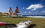 Men watch windsurfers at Hookipa Beach on Maui