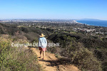 Hiker on the Temescal Ridge Trail, with Santa Monica Bay in distance