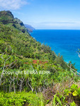 The Na Pali Coast on Kauai, with hiker on the Kalalau Trail and kayaks in sea