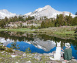 Hiker and dog relax at 20 Lakes Basin in the Eastern Sierra