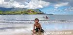 Boy playing at the beach in Hanalei, Kauai