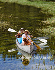 Golden retrievers share canoe with couple in Twin Lakes in the Mammoth Lakes Basin