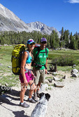 Hikers with dog in Little Lakes Valley in Rock Creek Canyon