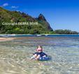 Girl enjoying beach in Haena, Kauai
