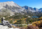 Hiker at overlook sees Little Lakes Valley in Rock Creek Canyon in autumn