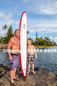 Father and son with surfboard in Lahaina, Maui