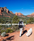 Hiker and dog on the Soldiers Pass Trail in Sedona