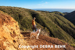 Hiker with dog sees ocean beyond Solstice Canyon in Malibu
