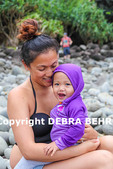 Mom with baby at Hanakapiai Beach, reached by hiking  the Kalalau Trail