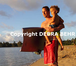 Man with son at Hanalei Beach