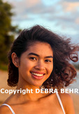 Young woman at beach in Kaanapali, Maui, at sunset