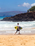 Skimboarder at Makena Beach on Maui