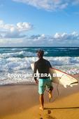 Surfer at Hookipa Beach on Maui
