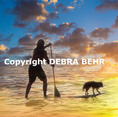 Paddler with dog at sunset