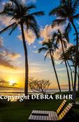 Golden light illuminates chairs at sunset at Kaanapali, Maui