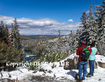 Tourists look at Twin Lake in the Mammoth Lakes Basin