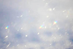 Snow crystals acting as prisms. Sparkles
