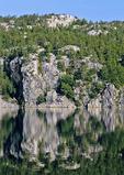 Quartzite Ledges Reflecting in George Lake at Killarney Provincial Park