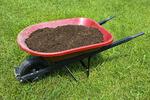 Wheelbarrow of shifted garden compost